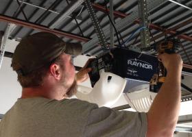 Repairman fixing Garage Door Opener
