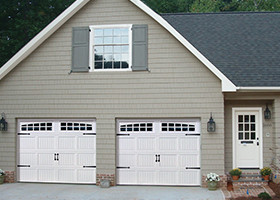 ap138-inpage-front-of-gray-house-with-2-white-garage-doors